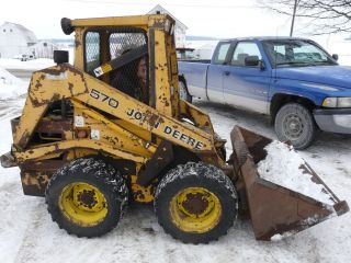 John Deere 570 Skid Steer Loader with Kubota Diesel Engine Runs Drives and Lifts