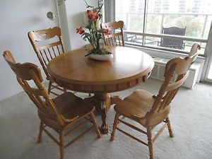Round Oak Table and Four Chairs with One Large Leaf Very Nice Golden Oak not Old