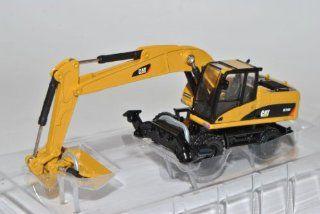 Cat M318D Bagger mit Reifen Caterpillar Baufahrzeug H0 1/87 Norscot Modell Auto mit individiuellem Wunschkennzeichen: Spielzeug